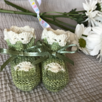 knitted baby booties with daisy chain cuffs