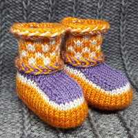 knitted baby booties with latvian braids and colourwork