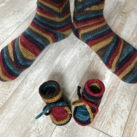 matching knitted baby booties and socks